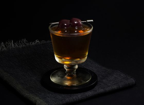 Black Manhattan cocktail photo